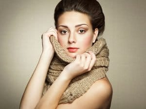 Portrait of a beautiful young woman with perfect skin and scarf
